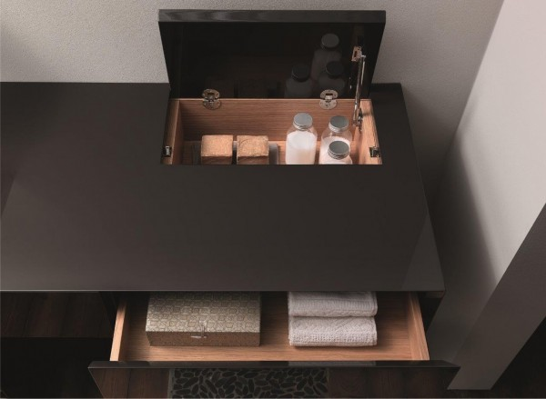 A storage section accessed via the top of this bathroom vanity unit is an unexpected find, and it's easy to see how top accessed storage cubbies could keep countertops clutter free.
