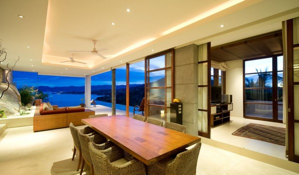 Swish interiors with an expensive feel welcome the owner to their high-class holiday home that has a multi-level design, layered into the coastal rock formation.