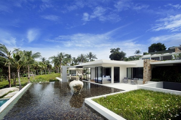 A carefully considered landscaping design ensures that the outdoor beauty continues from the rocky shoreline, and adjoining coconut grove, right up to every doorstep of the home.