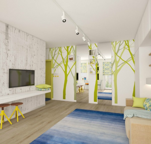 On the opposite wall, bold green tree silhouette wallpaper spans the area, along with two floor to ceiling mirrors that create the illusion of extra space and light.