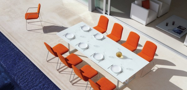 Orange outdoor chairs will bring sunshine to the dullest of days.