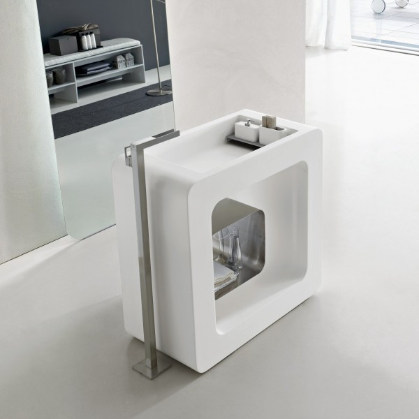 This cube vanity-basin combination provides a unique opportunity for central room placement, creating a bathroom island that is facilitated by a chrome stand tap.