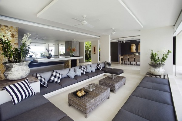 The modern monochrome seating area flows through to a dramatic dining room and a huge kitchen area, providing a great free-flowing space for entertaining, with plenty of comfortable places for guests to perch.