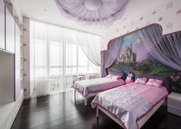The kids' bedroom takes a break from the taupe color scheme, and instead is a purple and pink fairytale room complete with castle mural.