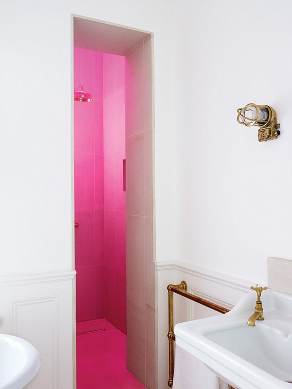 This traditional room receives a blast of modernity in the form of a vivid pink pop.