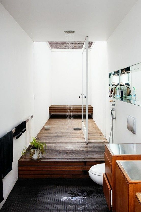 This unusual layout gives the shower its own stage.