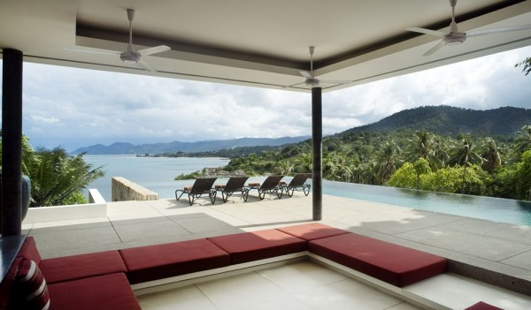 The kitchen opens up to a sunken lounge that leads out to the infinity pool that features underwater speakers–part of the homes amazing sound system–for when you are taking a dip.