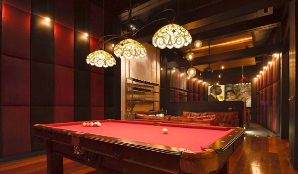 If you don't fancy a work out or a plunge in the swimming pool, then how about a game of pool on your own table, nestled in the cozy entertainment den that has been furnished with plush leather sofas.