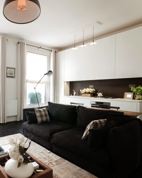 Our first small apartment design is a London pad, measuring 521 square feet, or 48 square meters. Two large windows help out here by filling the compact space with natural light, but the décor scheme helps things along with an airy, bright palette.