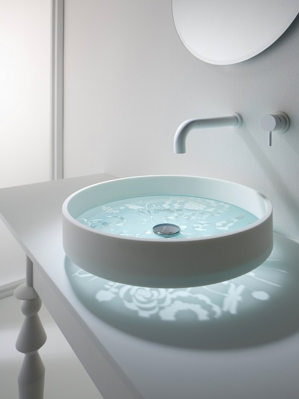 Our first interesting find under a faucet is this elegant bathroom basin that has an etched glass base. When raised up on it's waste collar, the base casts a beautiful light pattern over the surface of the vanity unit below.