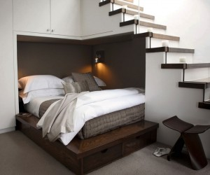 One example of simple space repurposing would be to utilize the unused area under a staircase, like this cozy double bed set up. The custom made platform bed fits snugly into the under-stair alcove, and the design also incorporates under-bed and over-bed storage that runs straight into the side of the stairs too.