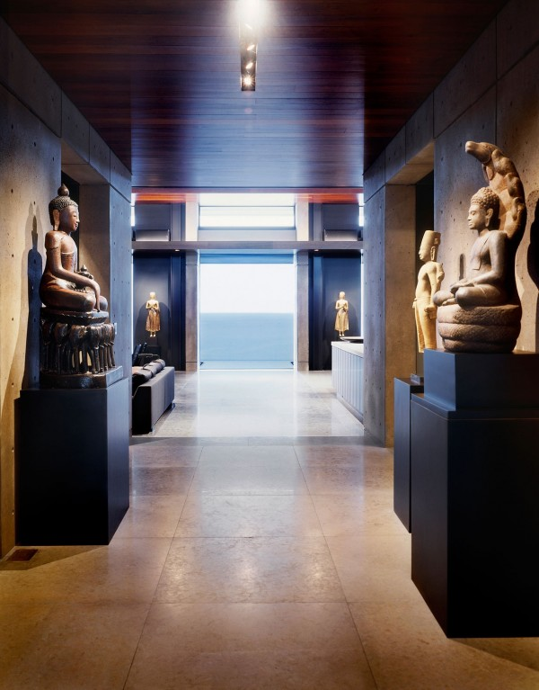 The home entryway holds the majesty of an art gallery, or perhaps the hush an ancient temple.