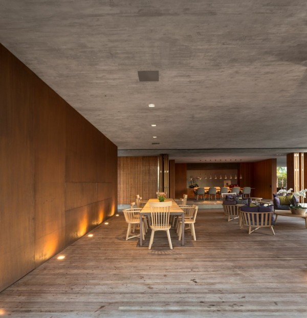 Inside the home, the concrete that forms the building remains exposed across ceilings and selected walls.