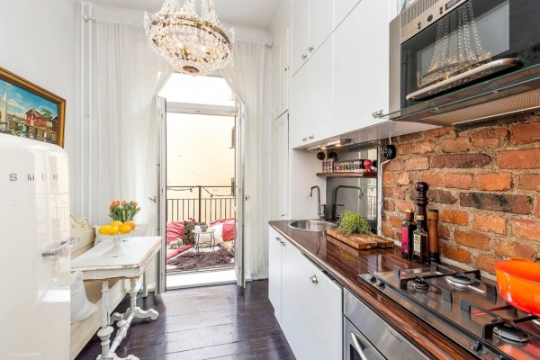 The eclectic kitchen is a stunning little gem that leads out onto a romantic balcony.