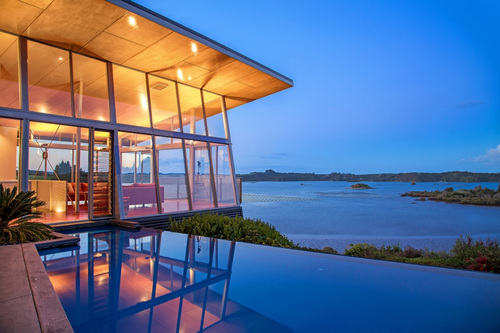 An amazingly beautiful modern waterfront house from new for Contemporary house designs nz