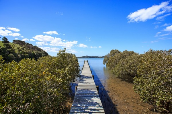 An 80 metre long jetty juts into the serene lake water.