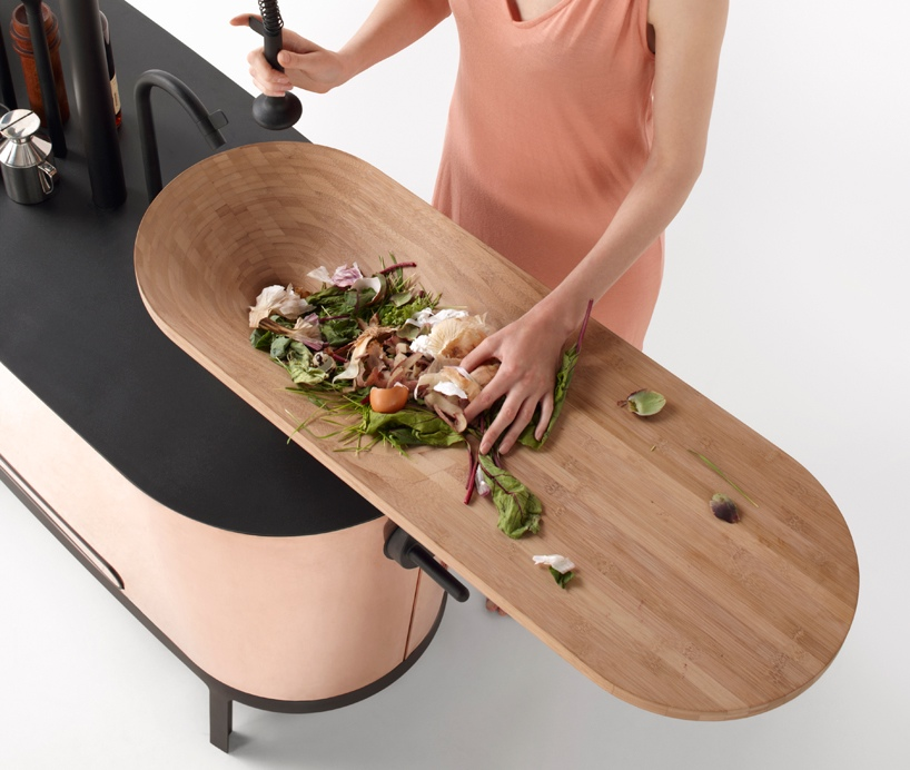 chopping board sink makes for a seamless prep area in the kitchen