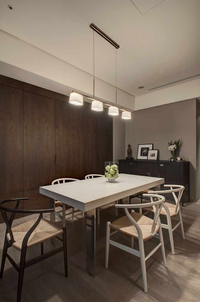 Contemporary Dining Room - Two chic apartments with adaptable home style