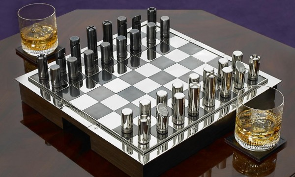 The chic $1995.00 Hammond chess set, from the Ralph Lauren Home collection, could possibly be mistaken for a set of rather expensive pen caps in a smart home office.