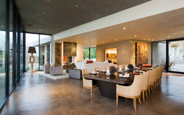 The airy open plan layout, with décor put together by noted interior designer Chris Reed, holds a spacious living room, dining area and stylish gourmet kitchen, all with neutral color scheme heated only by the occasional pop of orange accent pieces.