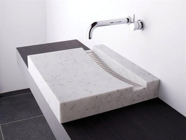 Another sink formed from Cristalplant (which is the first eco-sustainable solid surface made from materials of plant origin combined with natural inert minerals of absolute purity) is this chunky block cut through with a slimline grate drain.