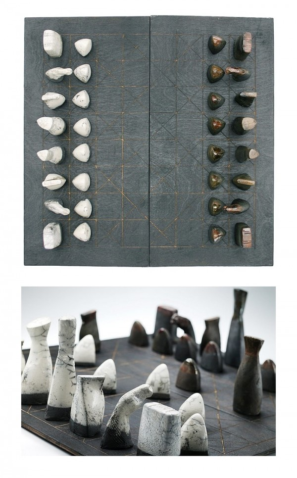 Ceramic chess pieces, set out on this intriguing board of black burnt plywood, will bring a mystical stone age appeal to any space–perfect for a traditional library.