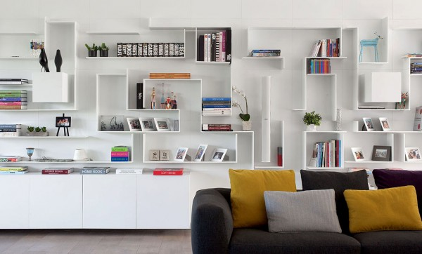 Small cube cupboards extrude from the wall to create added interest amidst the maze of white shelving.