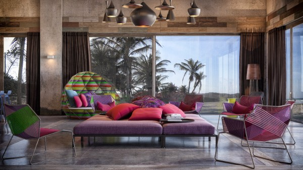 The bright chairs and pouffes work perfectly against the Caribbean island backdrop of tropical palm trees beyond the windowpanes.