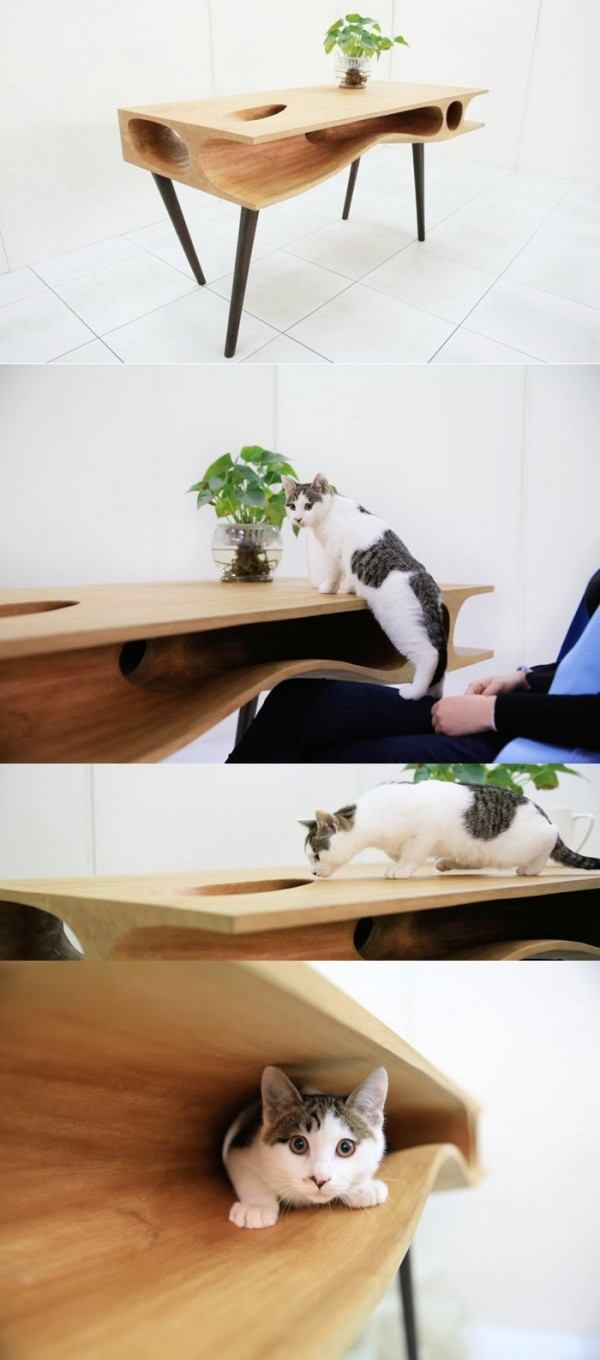 Cat lovers, here you go! A beautifully crafted desk that offers up a fun run for your feline friends whilst you work... or try to!
