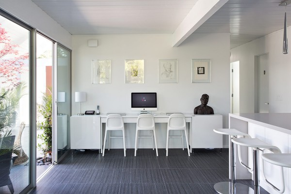 This triple seated home office area is a great addition for a modern family home with multiple computer users. Two large storage cupboards on either side of the long desk creates a great opportunity for hiding away the usual workspace clutter of printers, scanners, disks, ring-binder files and stationery supplies.