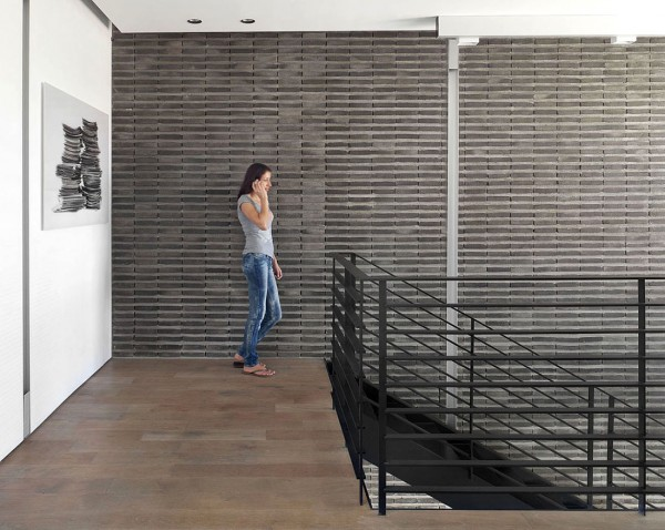 An industrial style metal staircase fits the style of the space perfectly.