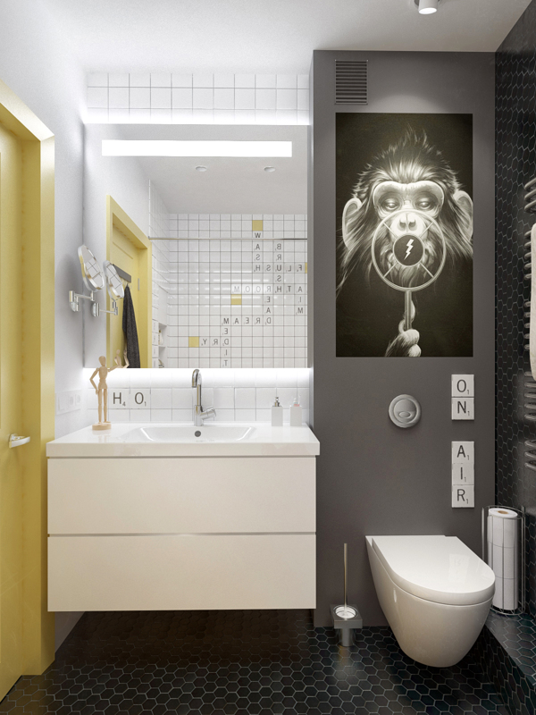 The small bathroom is decorated with unusual artwork and eye-catching scrabble style tiles to draw attention away from its limited size.
