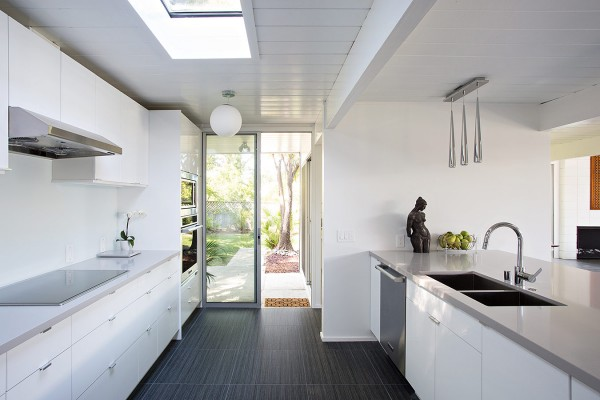 The kitchen is light and bright, with a set of glass doors that run right out into the garden.