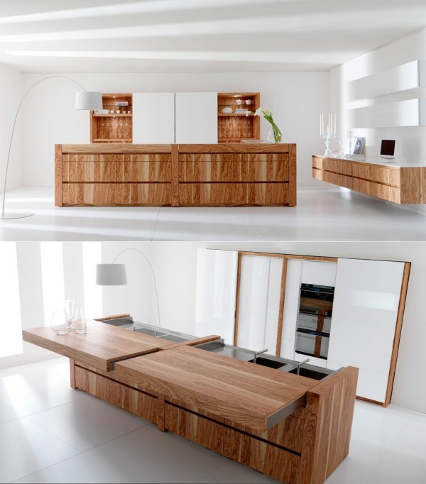 On the Essential kitchen, by Toncelli, an olive wood surface electronically slides away to reveal stainless steel food prep and cooking zones, doubling the work area. Photoelectric cells sense potential dangers/obstacles (such as other people/children/pets) and will block its movement to prevent harm.
