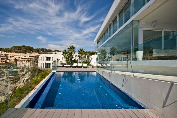 An infinity pool offers a private place to cool off away from the social beaches of the Balearic Island.