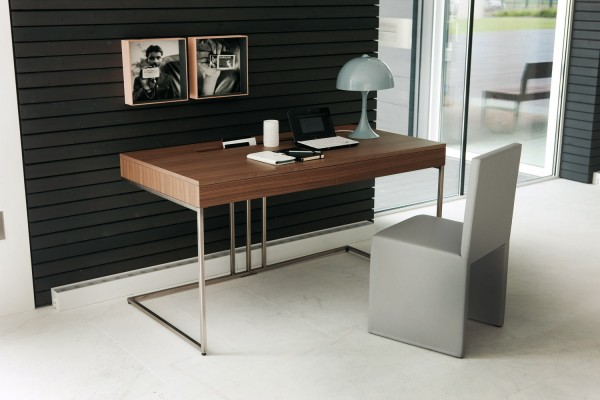 Of course, workspaces don't have to be hidden away, a sleek contemporary desk design can make a beautiful furniture addition to a room too.