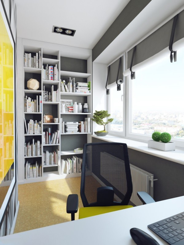 A large window floods the side office in natural light, illuminating a built in bookcase.