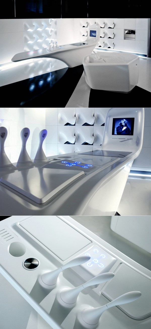 A  futuristic style kitchen offering an array of electronic features, with a top that integrates 2,000 LEDs, a built-in membrane to keep food warm for an extended period of time, and 3 scent dispensers to release a range of aromas. In the vertical extension, an upright screen enables the user of the cook zone to watch TV or surf the internet.