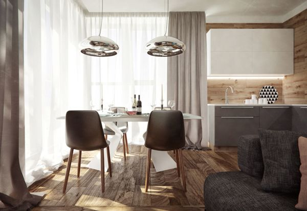 The entire first floor open plan scheme gathers warmth from wood clad walls, and its sharpened by shiny chrome accents.
