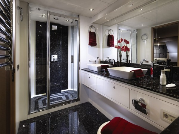 A granite floor, countertop and shower wall gives this bathing space a sense of style and expense.