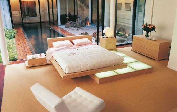This Japanese inspired bed incorporates an eye-catching illuminated platform, but the room is still based on a zen theory of clean lines and warm natural hues.