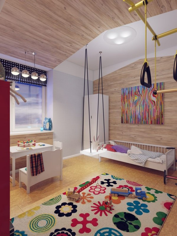 This colorful kids room is filled with warm and cozy lighting, casting a fuzzy glow against wood paneling.