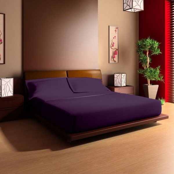This platform bed has been updated with a bright bedspread.