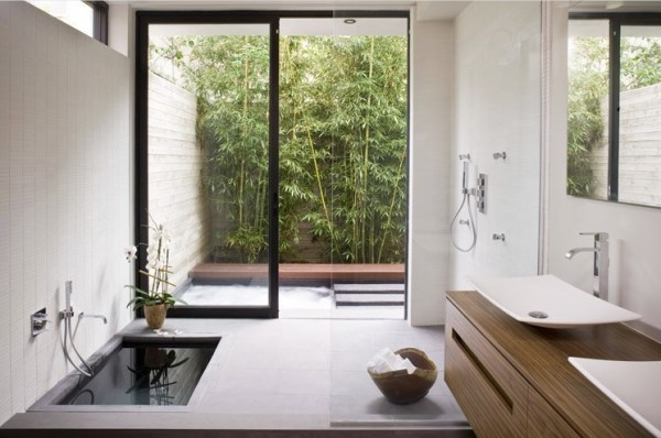 A sunken bath tub takes the minimalistic zen look a step further.
