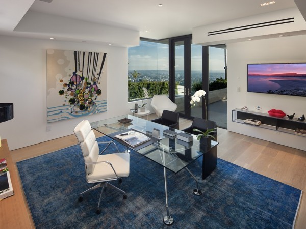 Many walls of the three story home are made from glass in order to soak up that view above Sunset Strip.