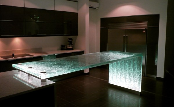 Drama is brought to this cooking space with the introduction of a textured glass counter that scatters the light, looking almost like flowing water.