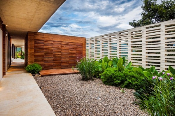 Gardens also find privacy behind the homes wooden casing.