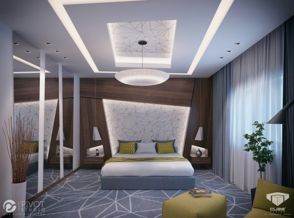 This forward-thinking geometric vision takes the sloping angles from the striking floor covering up over the illuminated headboard and directly into the over-bed units.