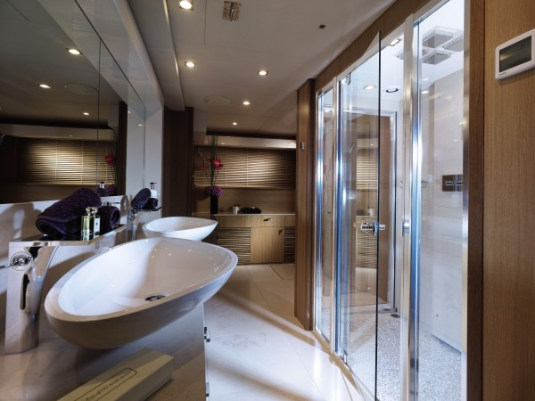 A large shower and twin basin vanity furnishes the sophisticated bathroom.