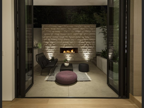 The luxury spills into the outdoor spaces, where furniture by Paola Lenti can be found.